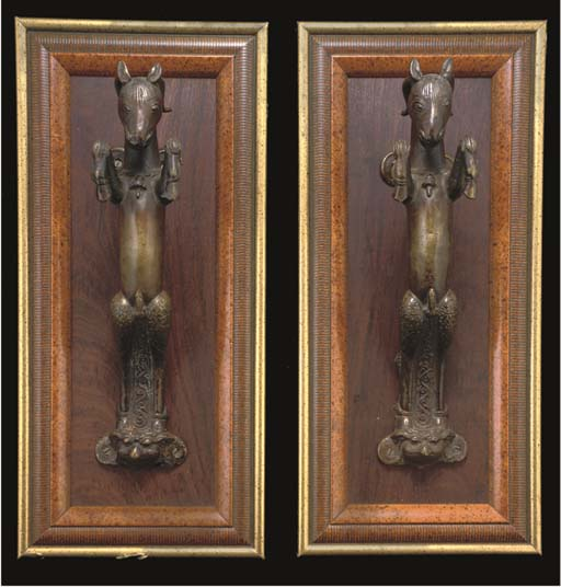 A PAIR OF BRONZE HANDLES IN TH