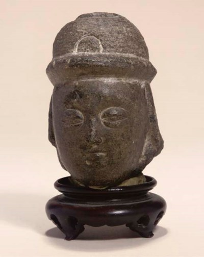 A small stone head fragment, M