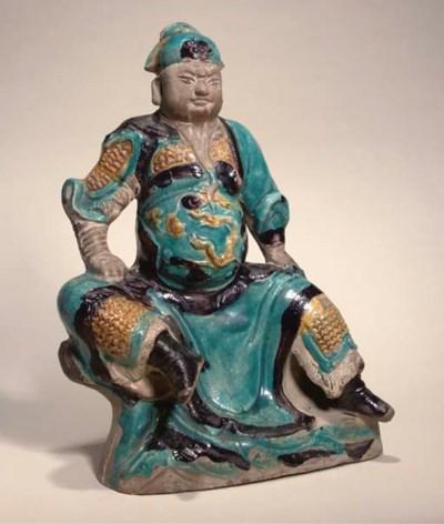 A fahua pottery figure of a wa