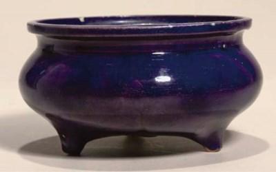 An aubergine-glazed tripod cen