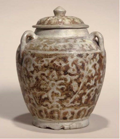 A brown-glazed jar and cover,