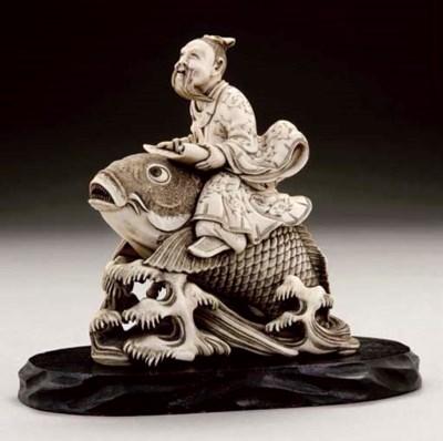 A Japanese ivory okimono of Ki
