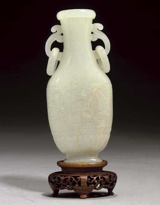 A PALE CELADON JADE TWO-HANDLE