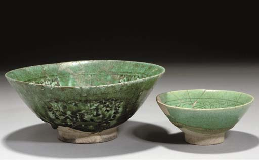 Two Nishapur green-glazed pott