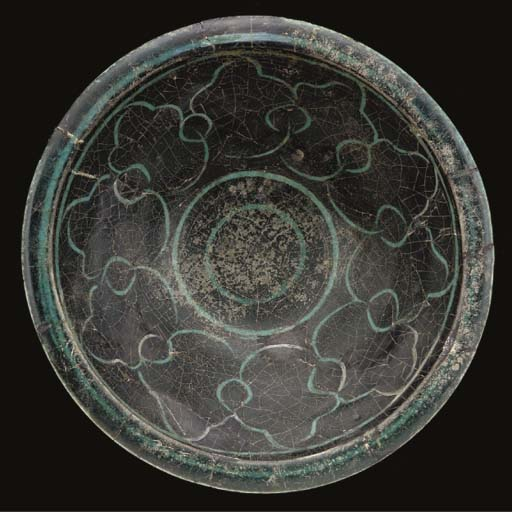 A Kashan silhouette-ware potte