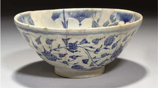 A BLUE AND WHITE IZNIK BOWL, O