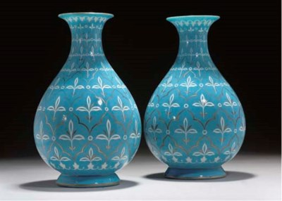 A PAIR OF BLUE GLASS VASES FOR