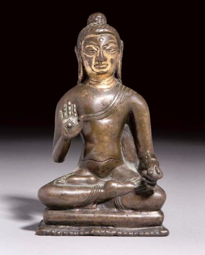 A Tibetan bronze figure of Amo