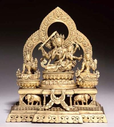 A Nepalese gilt bronze group d