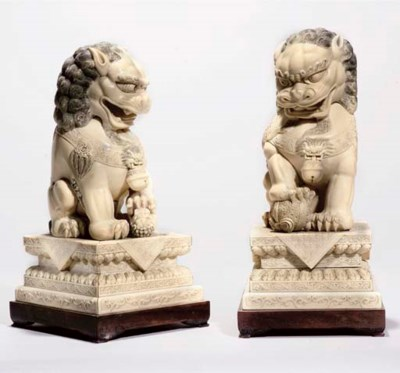 A pair of large ivory Buddhist