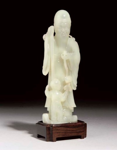A PALE CELADON JADE FIGURE OF