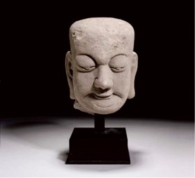A TANG DYNASTY STONE HEAD AND STAND