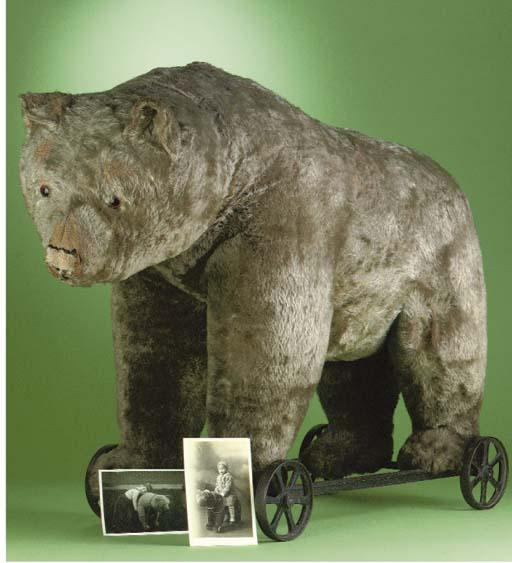 A large Steiff bear on wheels