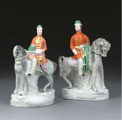 A PAIR OF STAFFORDSHIRE POTTER