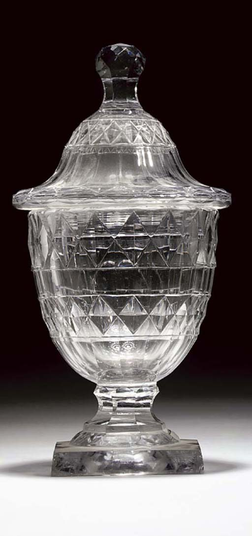 A CUT URN AND COVER