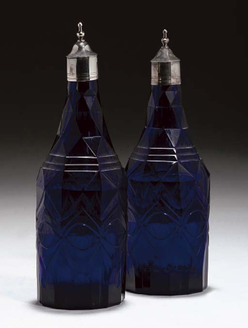 A PAIR OF BLUE GLASS OIL AND V