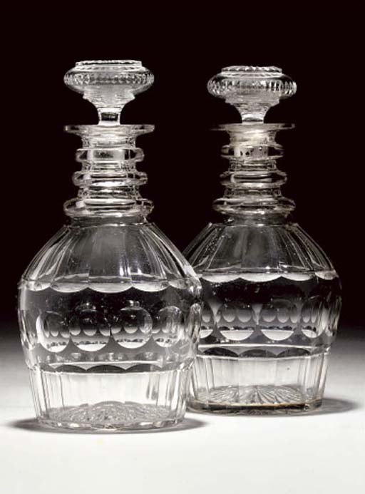 A PAIR OF DECANTERS AND STOPPE