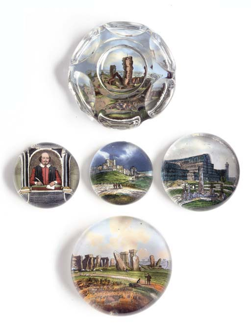 SIX PAPER-BACKED PAPERWEIGHTS