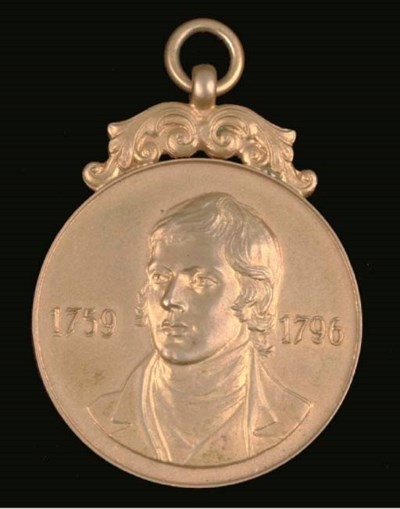 A 9CT GOLD FOOTBALL MEDAL
