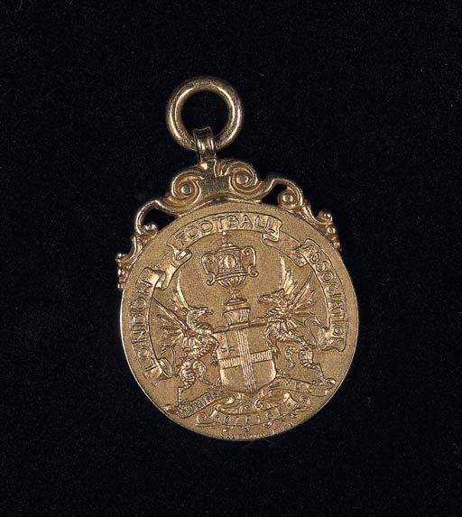 A 14CT GOLD MEDAL
