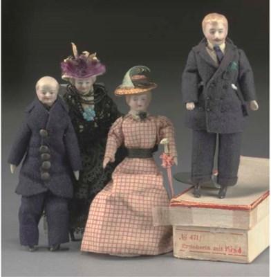 Four bisque headed dolls' hous