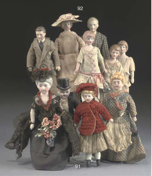 A group of bisque-headed dolls