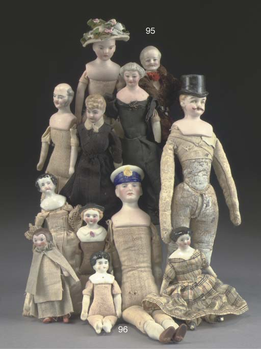 A quanity of dolls' house doll