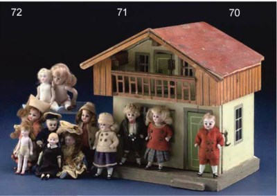 Two bisque headed dolls' house