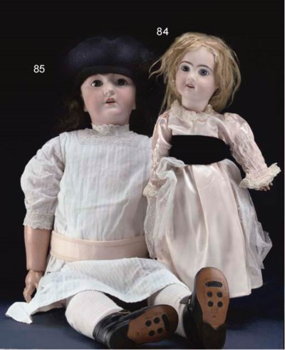 A large bisque headed doll
