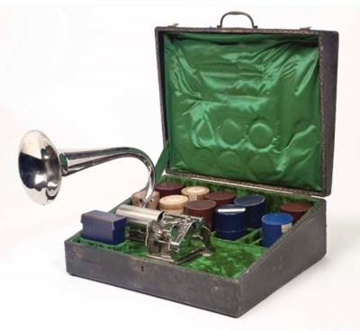 A rare Pathé Coq suitcase phon