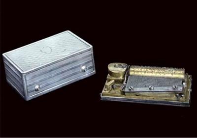 A fine silver cased musical bo