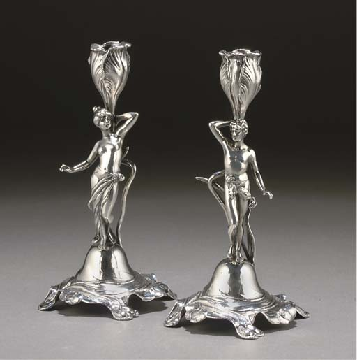 A PAIR OF WMF SILVERED METAL F