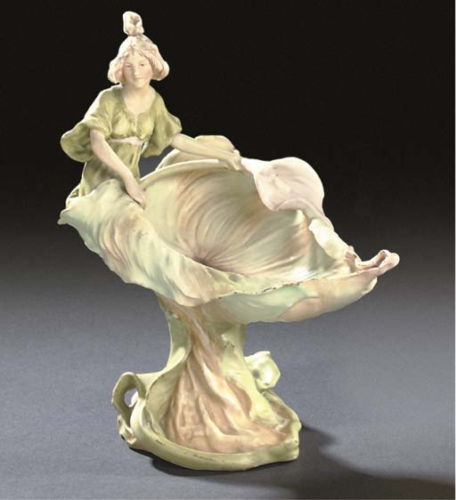 A ROYAL DUX GILT PORCELAIN FIG
