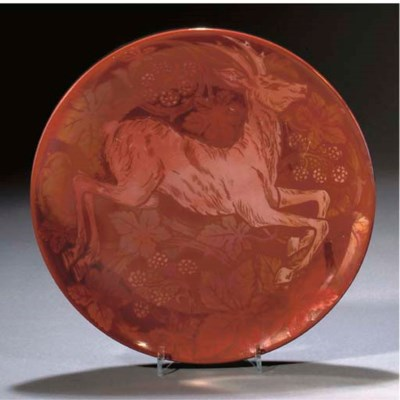 A POTTERY RUBY LUSTRE PLATE