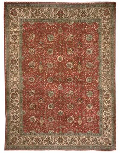 A fine Haghighi Tabriz carpet,