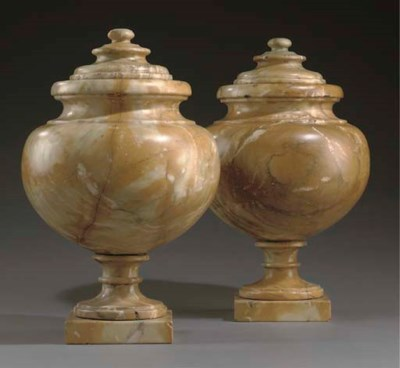 A PAIR OF ALABASTER URNS AND C