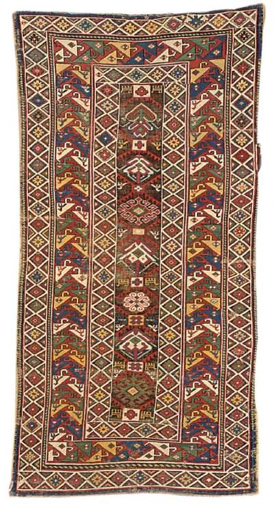 An antique Kazak rug & Khotan