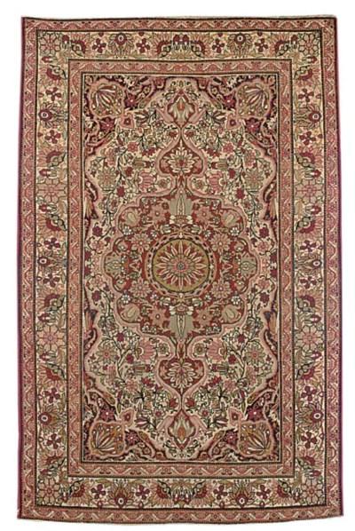 An antiaque Kirman Laver rug