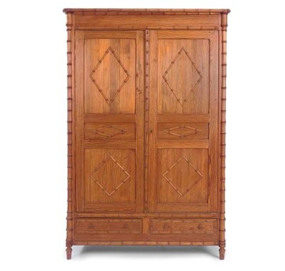 A FRENCH STAINED PINE ARMOIRE