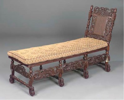 AN ENGLISH CARVED WALNUT CANED