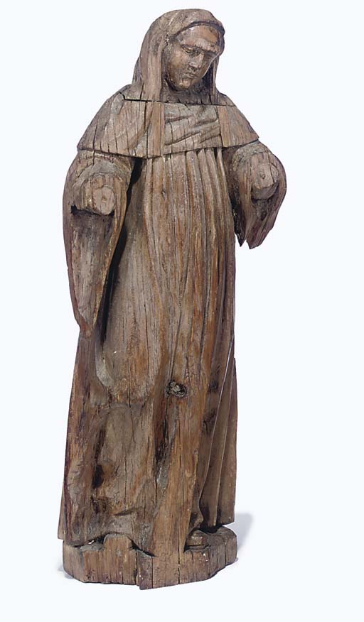 A SPANISH CHESTNUT CARVING OF