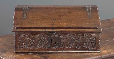 AN ENGLISH OAK SLOPING LID BOX