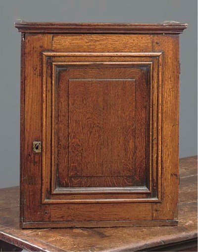 AN ENGLISH OAK SPICE CUPBOARD