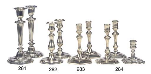 THREE GEORGE II PAKTONG CANDLESTICKS