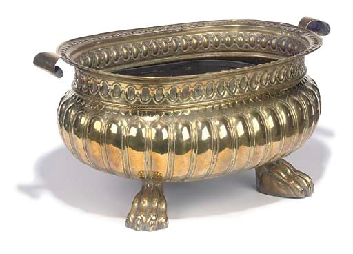 A BRASS OVAL WINE-COOLER
