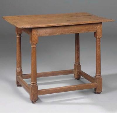 AN ENGLISH OAK CENTRE TABLE