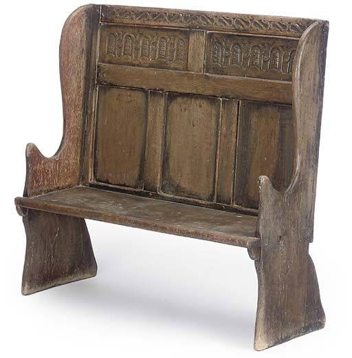 A SMALL OAK PANELLED SETTLE