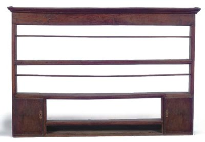 AN OAK PLATE RACK
