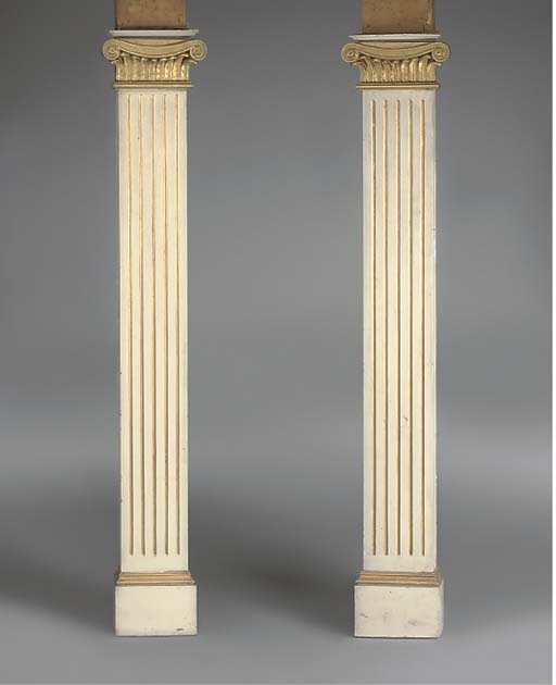 A PAIR OF GILT AND CREAM PAINT