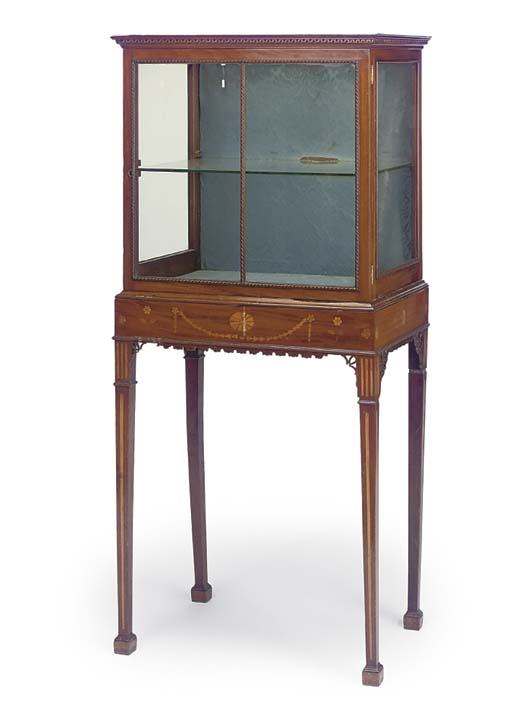 A MAHOGANY DISPLAY CABINET ON